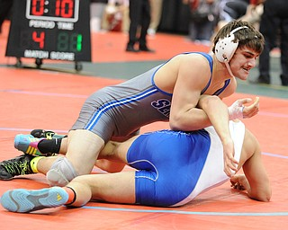 Mike Audi of Poland rolls over Tye Smith of Washington Court House to go for a pin during their 170lb Division 2 championship bracket bout during the State High School Wrestling meet on February 27, 2014 at Jerome Schottenstein Center in Columbus, Ohio.
