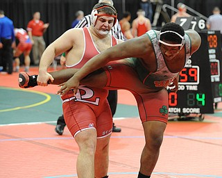 Cody Martsolf of Beaver Local attempts to go for the trip of Jquan Fisher of Toledo Central Catholic during their 285lb Division 2 championship bracket bout during the State High School Wrestling meet on February 27, 2014 at Jerome Schottenstein Center in Columbus, Ohio.