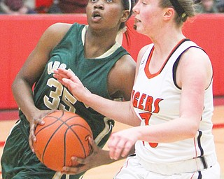 Ursuline's Tanaya Beacham drives around Mary Ritter of Springfield on Thursday at the Division III district 