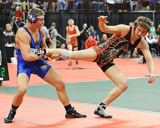 COLUMBUS, OHIO - FEBRUARY 28, 2014: Nick Cardiero of Girard attempts to hop out of bound before having his leg kicked out by Joey Meek of W. Salem Northwest during their 170lb championship bracket bout during the 2014 division 3 state wrestling tournament at Schottenstein Center.