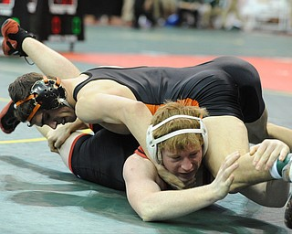 COLUMBUS, OHIO - FEBRUARY 28, 2014: David-Brian Whisler of Howland and Reyse Wallbrown of Indian Valley wrestle on the mat during their 152lb consolation bracket bout during the 2014 division 2 state wrestling tournament at Schottenstein Center.