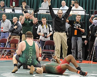 COLUMBUS, OHIO - FEBRUARY 28, 2014: The West Branch coaching staff celebrates after a pin by Logan Sharp over Jquan Fisher of Toledo Central Catholic during their 285lb championship bracket bout during the 2014 division 2 state wrestling tournament at Schottenstein Center...I could not get ID's of the coaches. I could not find them in the arena, and no one knew what their names were.