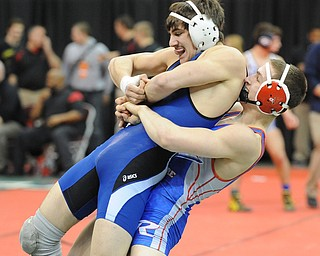 COLUMBUS, OHIO - FEBRUARY 28, 2014: Mike Audi of Poland is picked up by Zeck Lehman of Revere before being slammed to the ground.