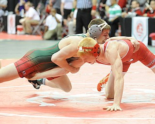 COLUMBUS, OHIO -FEBRUARY 28, 2014: Daniel Hasson of Beaver Local attempts to hold on to the leg of Josh Mossing of Toledo Central Catholic, as Mossing attempts to take his back during their 138lb championship bracket bout during the 2014 division 2 state wrestling tournament at Schottenstein Center.