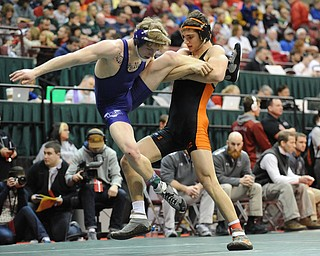 COLUMBUS, OHIO -FEBRUARY 28, 2014: David-Brian Whisler of Howland takes out the leg of Mike Repko of Vermilion before taking him to the mat during their 152lb championship bracket bout during the 2014 division 2 state wrestling tournament at Schottenstein Center.
