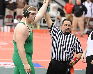 COLUMBUS, OHIO -FEBRUARY 28, 2014: Logan Sharp of West Branch has his arm raised by the referee in victory after a 285lb championship bracket bout during the 2014 division 2 state wrestling tournament at Schottenstein Center.