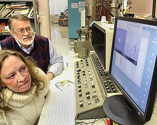 Carol and Andrew Hirt examine results at Materials Research Laboratories Inc., a state-of-the-art facility in Struthers that provides materials-analysis services to industries both domestic and abroad. The two own MRL, which has been located in the former Holy Trinity School since 1993.