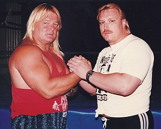 "Wrestler Greg ""The Hammer"" Valentine, left, poses with Pete Lucic — also known as Preston Steele — in this undated promotional photo. Lucic, 53, retired last week from the Trumbull County Sheriff 's Office after 33 years with the department but doesn't plan to stop his wrestling career, which has taken him to Australia, Italy, Germany, Denmark, Sweden, England and Japan."
