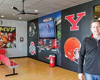 Rick Camardo, above, wanted to bring the franchise to Youngstown. The Boardman SportClips recently opened to provide a sports-themed environment for customers.