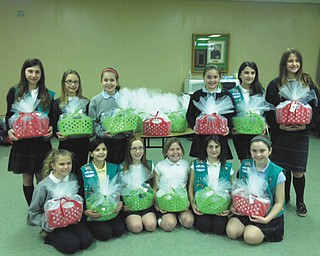 SPECIAL TO THE VINDICATOR Girl Scout Troop 157 of Holy Family School in Poland participated recently in a service project for the Touched by Nathan Foundation, which focuses on acts of kindness that provide comfort for the neonatal intensive care unit at Akron Children's Hospital at St. Elizabeth's and Special Care Nursery at Akron Children's Beeghly campus, both in Boardman. The girls made comfort baskets for the families of these fragile babies. The baskets include bottled water, mints, travel size shampoo, conditioner, pain reliever, toothbrush, toothpaste, powder, deodorant and other items families may need so they can stay close to their infant in the NICU. Kneeling, from left, are Caitie Palusak, Gia Diorio, Chloe Mershimer, Taylor Creighton, Madison Richey and Annie Daprile. Standing are Haley DiLullo, Leanne Chandler, Anna Wollet, Audrey Kali, Augusta Fox and Victoria Butera. Other girls who participated are Megan Brockway, Ava Szalay, Lucia Naples, Veronica Brown and Lucy Graziano.