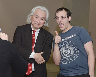 Physicist Michio Kaku poses with YSU student Dan Gallo of Hubbard before speaking to a group of students Thursday afternoon at Stambaugh Auditorium. Kaku also spoke Thursday evening to an audience at the historic North Side auditorium.