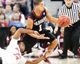 Harvard's Siyani Chambers (1) and Cincinnati's Ge'Lawn Guyn (14) fight for a loose ball during the second half