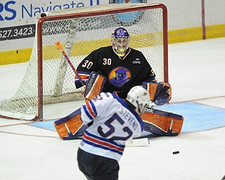 YOUNGSTOWN, OHIO - MARCH 21, 2014: Goalie Sean Romeo #30 of the Phantoms tracks down the puck after a shot from Brody Stevens #52 of Team USA during the 2nd period of Friday morning against Team USA at the Covelli Centre. The Phantoms won 7-3.