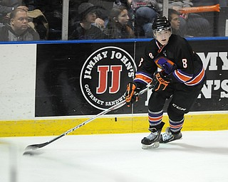 YOUNGSTOWN, OHIO - MARCH 21, 2014: Josh Melnick #8 of the Phantoms skates with the puck during the 3rd period of Friday morning against Team USA at the Covelli Centre. The Phantoms won 7-3.