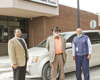 From left, Joseph Hightower, Robert Faulkner and Lyudee Womack stand in front of a new van purchased with grant money by the United Methodist Community Center to transport veterans to appointments and help eliminate barriers to jobs.