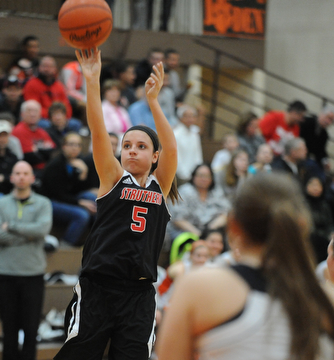 HOWLAND, OHIO - MARCH 25, 2014: McKenna Shives #5 of Struthers takes a three point shot during the second half of Tuesday nights Frank Bubba Classic girls basketball all-star game at Howland High School. Mahoning County won  67-62.