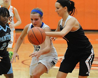 HOWLAND, OHIO - MARCH 25, 2014: Ashleigh Ryan #1 of Struthers slaps the ball away from Alli Pavlik #15 of Lakeview during the second half of Tuesday night's Frank Bubba Classic girls basketball all-star game at Howland High School. Mahoning County won  67-62.