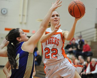 HOWLAND, OHIO - MARCH 25, 2014: Gabby Cvengros #22 of Howland goes to the basket while being pressured by Kelsie Settle #14 of Sebring during the second half of Tuesday nights Frank Bubba Classic girls basketball all-star game at Howland High School. Mahoning County won  67-62.