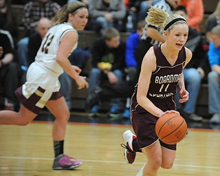 HOWLAND, OHIO - MARCH 25, 2014: Megan Volosin #11 of Boardman dribbles up court away from Leah Leshnack #12 of Liberty during the second half of Tuesday nights Frank Bubba Classic girls basketball all-star game at Howland High School. Mahoning County won  67-62.