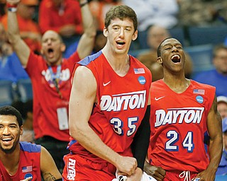 Dayton's Jordan Sibert (24) and Matt Kavanaugh (35) celebrate during their NCAA Sweet 16 game against Stanford on Thursday in Memphis, Tenn. The Flyers continued their Cinderella run by downing the Cardinal, 82-72, and reaching the Elite 8 for the first time since 1984.