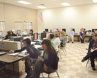 A group of Boardman teachers participates in a training course for Drund at West Boulevard Elementary on March 27. Drund, a locally developed secure social-media platform for schools, was founded locally and operates out of Boardman.