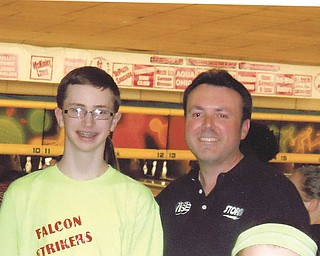 Ken Yokobosky, professional bowler and coach from New Jersey, posed for a photo between frames with a bowler from Austintown at the Hubbard Open Pro-Am on March 14. Photo by Doxie Damico of Austintown.