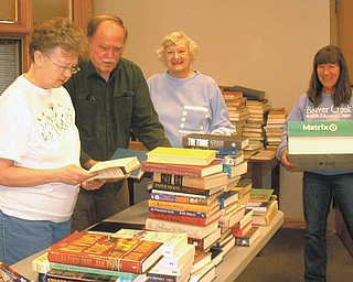 SPECIAL TO THE VINDICATOR Friends of the Columbiana Library are preparing for its book sale from 9 a.m. to 6 p.m. April 12 at Columbiana Public Library, 332 N. Middle St. Sorting the books are members,  Karen Campbell, left, Mike Vrable, Sandy Greathouse and Kathy Cattrell. The sale will include hardcover and paperback books, music, audio books and movies, all at bargain prices. Proceeds will be used for library programming and equipment. A members-only preview sale will take place from 6 to 8 p.m. April 11. Memberships for Friends of the Library can be purchased any time at the library. For information call the library at 330-482-5509.