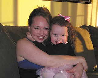 Elissa Rigby and daughter Norah are sharing a cuddle on Thanksgiving Day, taken by grandma Eileen Rigby.