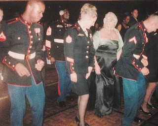 Rose Makosky, as her granddaughter's escort, is learning to do the electric slide with her granddaughter, Heather Leith, and other Marines at a Marine Corps Ball in California in 2006. Many of the Marines were recently home from Irag and reminded the family of how precious each day is.