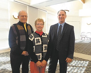 SPECIAL TO THE VINDICATOR At a recent meeting of the Friends of the Austintown Library, Robert Gavalier, right, updated the group on security and protection in the Austintown area. Tony Cebriak and Judy Cebriak also attended the meeting.