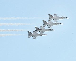The Air Force Thunderbirds fly in formation during the Thunder Over the Valley Air Show on Sunday at the Youngstown Air Reserve Station. After inclement weather threw a damper on Saturday's activities, Sunday's attendance was way up thanks to sunny skies and temperatures in the mid-60s.