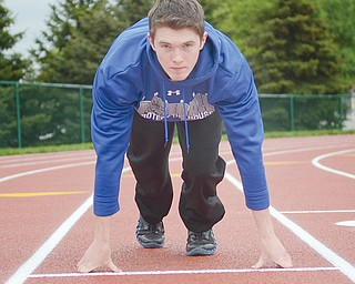 Poland's Aaron King, 18, warms up before a track meet last Friday at Hubbard High School. King has healed from tearing an ACL during a football game last fall.