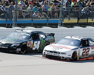 Ryan Blaney, right, tries to pass Sam Hornish Jr. during the NASCAR Nationwide auto race Sunday at Iowa Speedway in Newton, Iowa. Hornish won the race, and Blaney finished in second place.