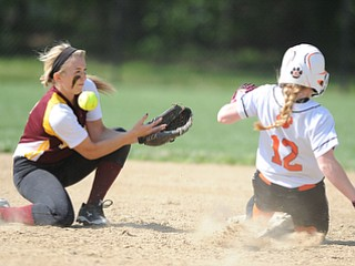 NORTH LIMA, OHIO - MAY 19, 2014: Infielder Stevie Taylor #8 bobbles the ball while trying to tag out a sliding Rhonda Rothacker #12 of Newton Falls as she steals second base in the top of the 3rd inning during a game at South Range High School. (Photo by David Dermer/ Youngstown Vindicator)