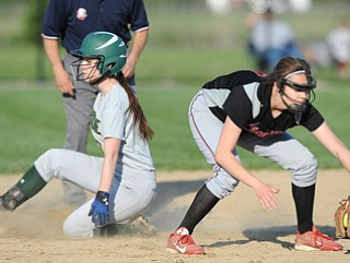 NORTH LIMA, OHIO - MAY 19, 2014:  Base runner Makayla Shore #00 slides into second base after a passed ball by Girard and beating the tag of infielder Mel Bakes #4 of Girard during a game at South Range High School. (Photo by David Dermer/ Youngstown Vindicator)