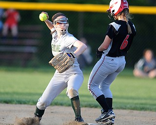 NORTH LIMA, OHIO - MAY 19, 2014: Infielder Anny Carroll #20 of Ursuline throws the ball to first after stepping on second base to force out base runner Annie Parillo #6 of Girard during a game at South Range High School. (Photo by David Dermer/ Youngstown Vindicator)