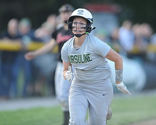 NORTH LIMA, OHIO - MAY 19, 2014: Base runner Stephanie Ohalek #9 of Ursuline sprints home to score the 3rd Ursuline run of the game after the throw went into the dead ball zone after a throw to third base during a game at South Range High School. (Photo by David Dermer/ Youngstown Vindicator)