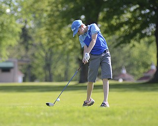 Katie Rickman | The Vindicator.Justin Atkinson, 12, of Brookfield golfs during the Greatest Golfer Junior Qualifier May 24, 2014.