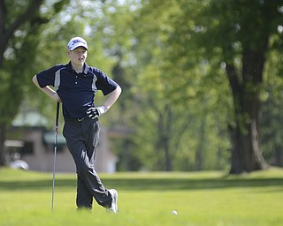 Katie Rickman | The Vindicator.Conner Stevens, 12, of Brookfield waits his turn during the Greatest Golfer Junior Qualifier May 24, 2014.