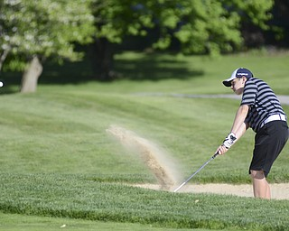 Katie Rickman | The Vindicator.Alec Hamilton, 15, of Austintown hits his ball out of the sand and onto the green during the Greatest Golfer Junior Qualifier May 24, 2014.