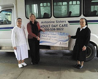 SPECIAL TO THE VINDICATOR The Antonine Sisters Adult Day Care of Canfield recently received a donation of $5,000 from Home Savings Charitable Foundation. The funds will provide transportation for elderly and disabled people to and from their homes and the care center. From left are Sister Jinane Farah, assistant director of Antonine Sisters Adult Day Care; Linda Jones, branch manager of Home Savings Austintown office; and Sister Marie Madeleine Iskandar, director of the Antonine Sisters Adult Day Care. For information about the day care and its services call 330-538-9822 or visit www.antoninesistersadultdaycare.com.