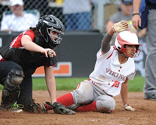 MASSILLON, OHIO - MAY 28, 2014: Base runner Haley Davies #25 of LaBrae slides into home plate to score the first LaBrae run in the top of the 3rd inning. Catcher Mackenzie Barker #4 misplayed the ball during a OHSAA tournament game at Massillon Washington High School. Manchester won 4-1. (Photo by David Dermer/Youngstown Vindicator)