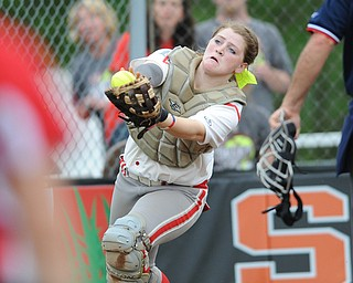 MASSILLON, OHIO - MAY 28, 2014: Catcher Kasey Rininger #10 of LaBrae looks the ball into her glove for the first out in the top of the 5th inning during a OHSAA tournament game at Massillon Washington High School. Manchester won 4-1. (Photo by David Dermer/Youngstown Vindicator)
