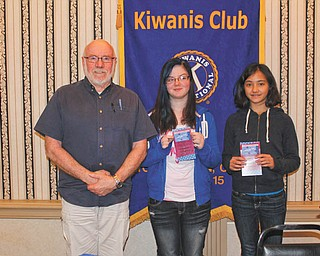 SPECIAL TO THE VINDICATOR Annabelle Day, right, grand champion of the 81st Annual Vindicator Regional Spelling Bee in March, and Morgan Smith, center, runner-up, were honored at the May 16 lunch meeting of the Downtown Kiwanis at the Downtown YMCA. Gary Winslow, Kiwanis member, presented the girls with gift cards to Barnes & Noble. Annabelle is a seventh-grader attending Willow Creek Learning Center, and Morgan is a seventh-grader attending Discovery at Kirkmere.