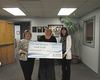 SPECIAL TO THE VINDICATOR Home Savings Charitable Foundation recently donated $10,000 to Second Harvest Food Bank of the Mahoning Valley. Second Harvest will use the funds for construction of a truck shelter to increase safety of the employees and drivers. From left are Kim Gennaro, branch manager of Home Savings Liberty office; Miriam Klein, grant officer of Second Harvest; and Jeannette Montgomery, retail manager of Home Savings Liberty office. For information about Second Harvest call 330-792-5522 or visit www.mahoningvalleysecondharvest.org.