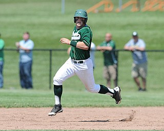 MASSILLON, OHIO - MAY 29, 2014: Base runner Michael Montalbano #23 of Ursuline sprints to second base to complete a RBI double during a OHSAA tournament game at Massillon Washington High School. Ursuline won 7-5. (Photo by David Dermer/Youngstown Vindicator)