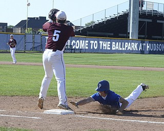 Katie Rickman | The Vindicator.Polands Marty Malenic (11) slides back into first base safe after trying to steal third during the first inning, Woodridge's Tom Finegan (5) stands on first base and tries to tag him out.