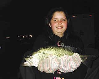 My daughter Kasena Thompson with her first bass of the season caught at Green Acres Lake Park Campground in Lake Milton. Sent by her dad, Ricky Thompson.