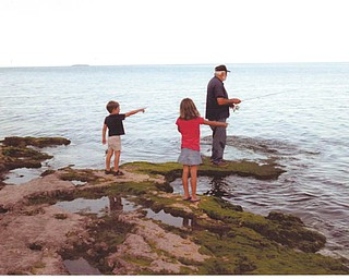 Grandpa Larry Bennett of Greenford was fishing while grandchildren Elise and Ethan Bennett of Westerville did the directing at Put-In-Bay on Lake Erie. Sent by Kathy Bennett of Salem.