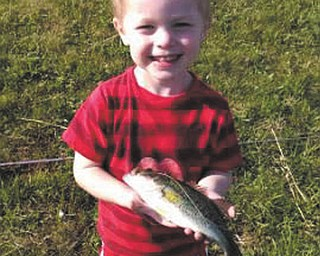 "Caden Jones, 3, of New Middletown, was ""reelly"" proud to bring in this whopper of a bass while fishing for the first time ever on May 19 with his dad, Ryan. The picture was taken at the neighborhood pond and submitted by mom, Angela."